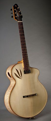 """Imperial by Erich Solomon. 16"""" cutaway archtop guitar with nature inspired """"leaf"""" soundholes. Hand carved European spruce top with X bracing. Hand carved curly European maple back and sides. Hand made by luthier Erich Solomon. 22 Old Stagecoach Road. Epping, New HAmpshire 03042. USA.. www.solomonguitar...."""