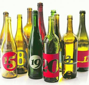 Use empty wine bottle as table number stands color labels can be purchased paper source - Empty colored wine bottles ...