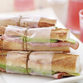 Wrap sandwiches in paper and twine for a picnic.
