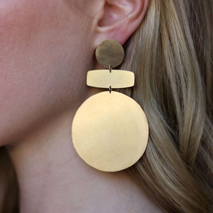 Lightweight, hand-cut statement earrings in gold plated brass with sterling silver ear posts. Measures 7.5cm high x 5cm wide. Handmade in our Melbourne studio.