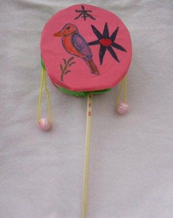 Activities: Chinese Hand Drum....cardboard or plastic with construction paper on dowel