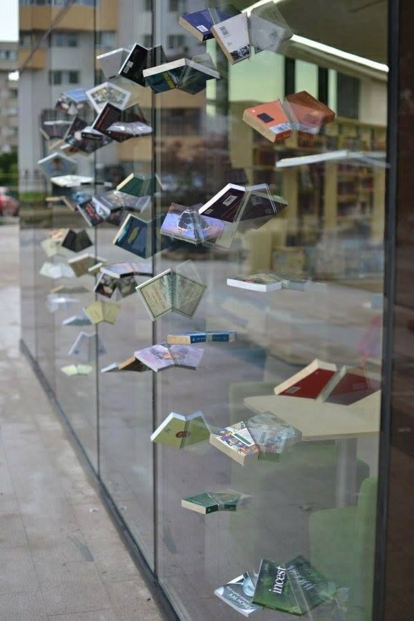 Suspended books... really cool window decoration!
