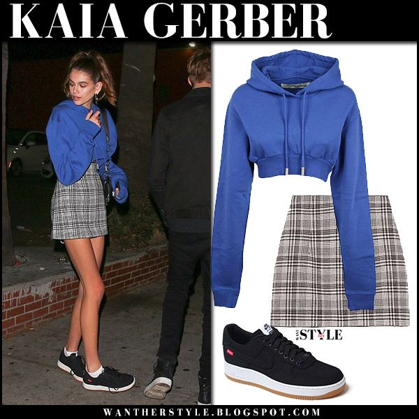 Kaia Gerber in blue cropped hoodie, grey mini skirt and black sneakers