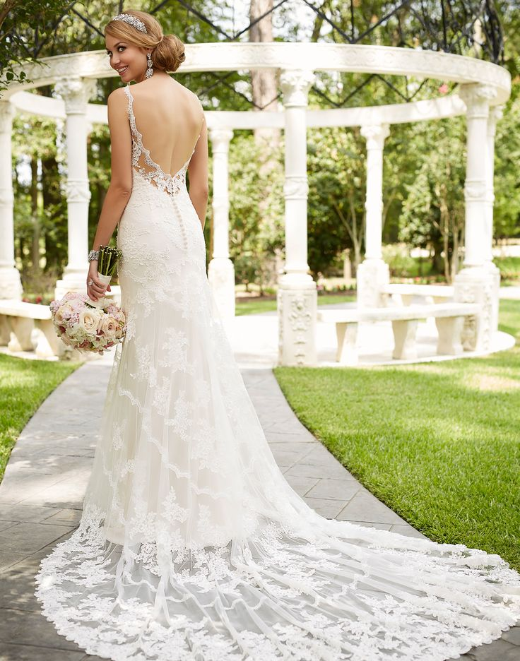 6247 // Antique-inspired romantic lace detailing adorns this modified fit-and-flare wedding gown from Stella York.