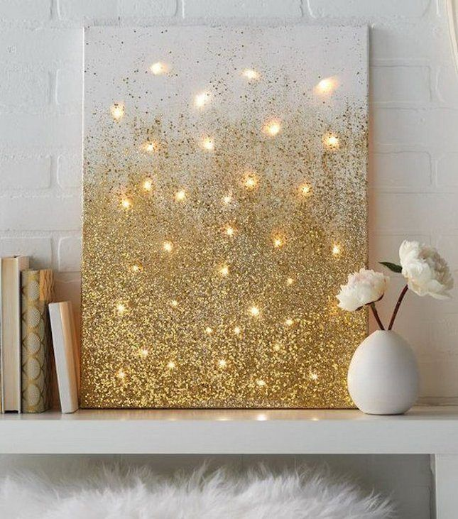 Brighten up your home with another take on the fairy lights canvas but with a touch of glam. Coat a canvas frame with glue and a generous dose of gold glitter to achieve this look