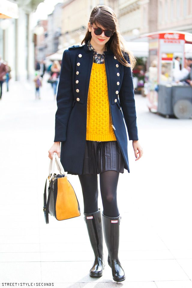Navy coat, winter must have classic: With pleated leather mini skirt, Hunter boots and yellow sweater.