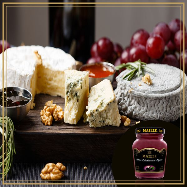 Entertain with ease for a gourmet Thanksgiving by crafting an assorted cheese plate to pair with our Dijon blackcurrant mustard! #MyMaille
