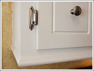 Add molding to the bottom of your kitchen cabinets!
