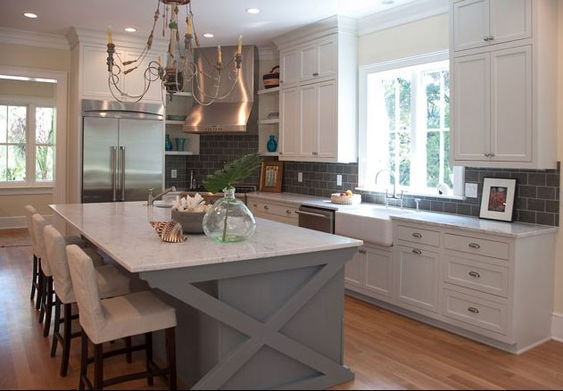 White kitchen with painted island… I like the charming cross beams on the isla