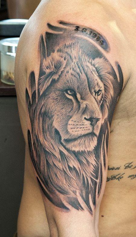 Black and gray lion head tattoo on half sleeve