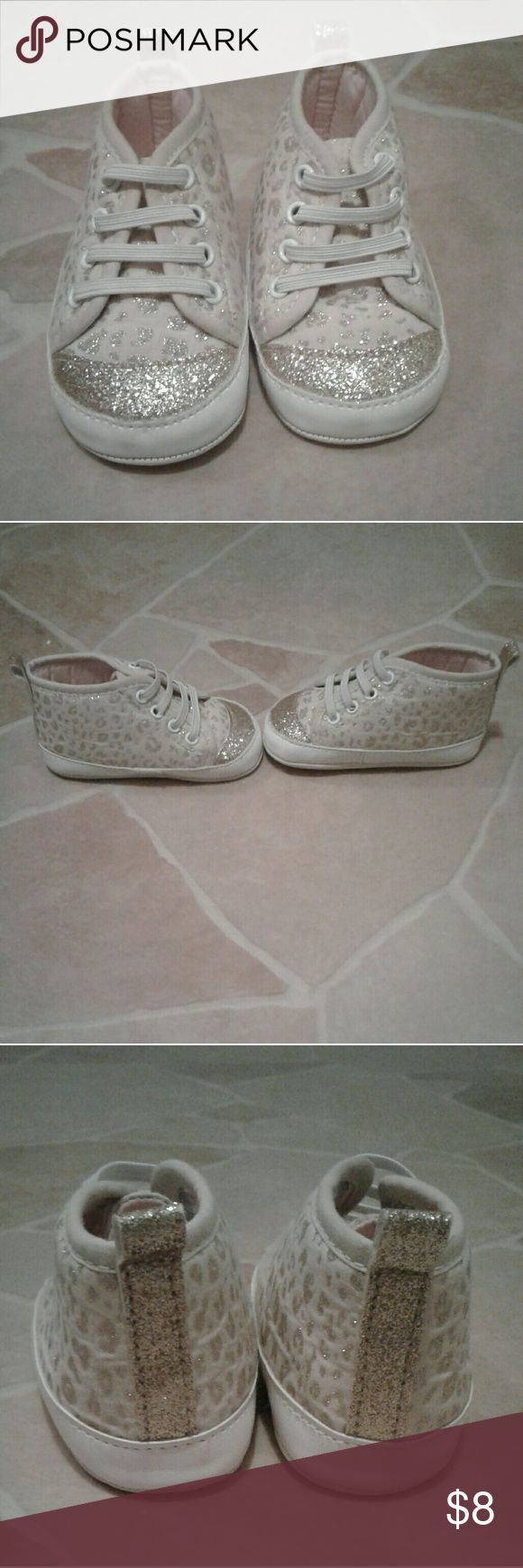 """JUST FOR YOU HIGH TOP GLITTER CHEETAH SHOES Excellent condition worn a couple of times. These high top shoes are adorable. The entire shoe is glitter cheetah print all the way to the glitter toe of the shoes. The """"shoe laces"""" are elastic so it's very easy to slide on or off! These are a size 3- 6 month in baby. Just For You Shoes Baby & Walker"""