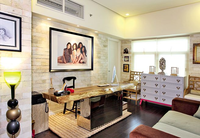 KC%u2019s home office features an eclectic combination of elements. The kamagong desk with a steel base is anchored on a rug made of woven rattan. Right behind the desk is a wall adorned with coral stones. On one side of the room is a light purple chest of drawers with a touch of hot pink%u2014an interesting burst of color in this space full of neutrals.