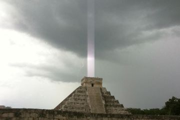 Such an amazing image.  No, it doesn't mean the Mayan gods are coming to get us, it means the guy's iphone got confused by a lightning flash, alas.