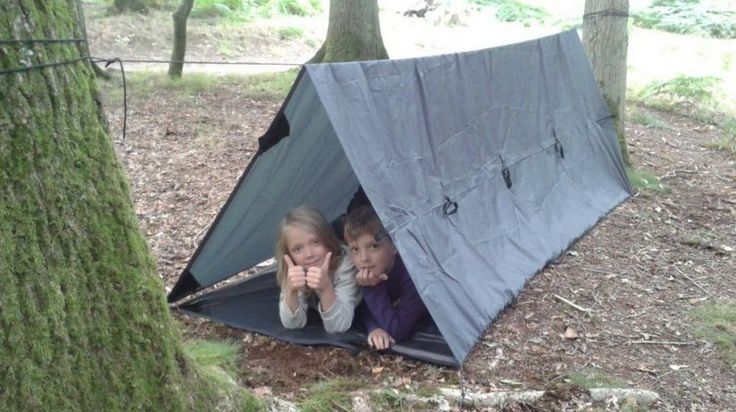 Tarp Shelter: Survival Life Guide On Building Shelters | https://survivallife.com/tarp-shelter/