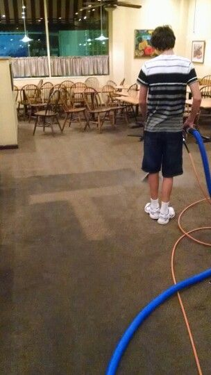 T for teaching the son how to clean carpet.