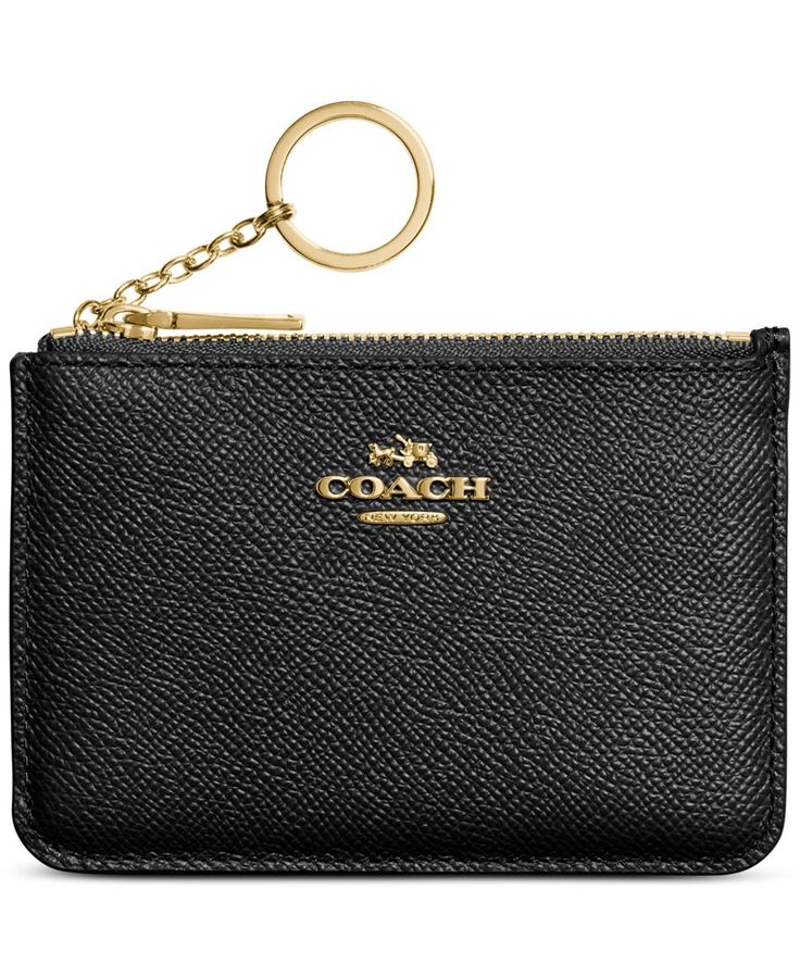 This charming pouch is crafted in delicately textured leather and accented with…