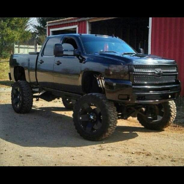 lifted silverado custom studded tires towing mirrors