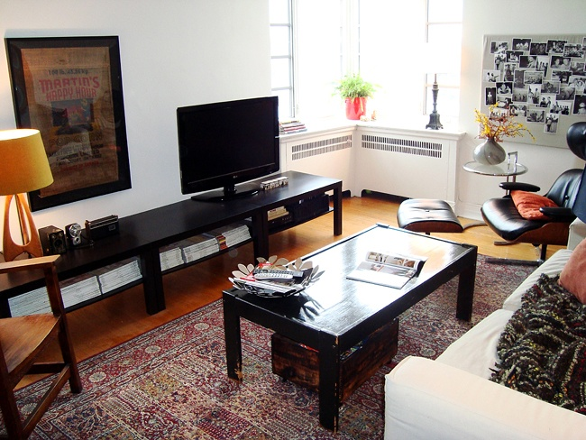 Three IKEA coffee tables used as a long, low TV bench