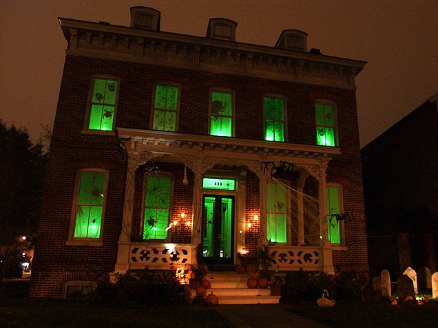 Over-the-Top Halloween Home Decorations - iVillage I like the simple green light and spiderweb decorations!