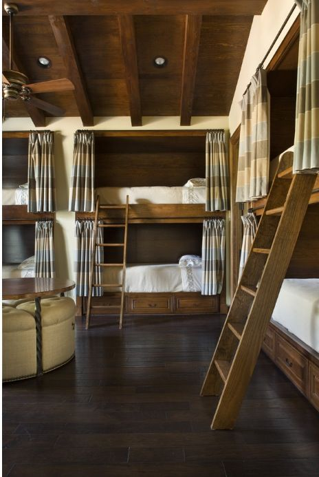 Love built-in bunks for lake house guest room.  I like the curtain idea so you can put some kids to bed before others and have them not be disturbed when the older kids come in.