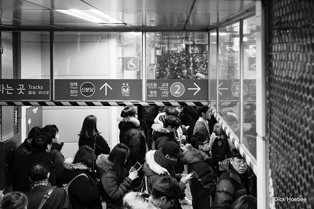 Rush hour in Seoul, South Korea. The crowd is so dense and pushy, barriers are needed to keep people from spilling onto the tracks. #Gangnam #Gangnamstyle #Korea #ROK #Seoul #B&W #citylife #city #subway #metro #Travel #SonyRX1R #Adobe #Lightroom
