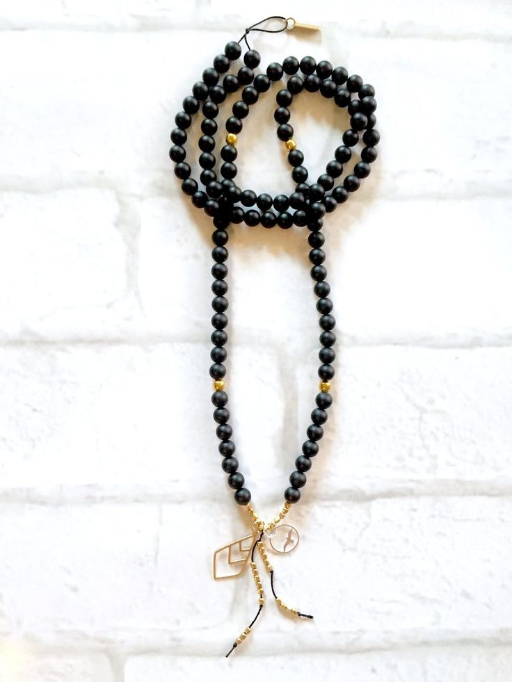 Black Onyx Mala Necklace Intentional jewelry made with black onyx gemstones and sacred geometry pendents. Used during meditation, yoga practice or simply worn as a beautiful piece of jewelry. Each gemstone hold unique healing properties and can be used as a daily reminder of your positive intentions.