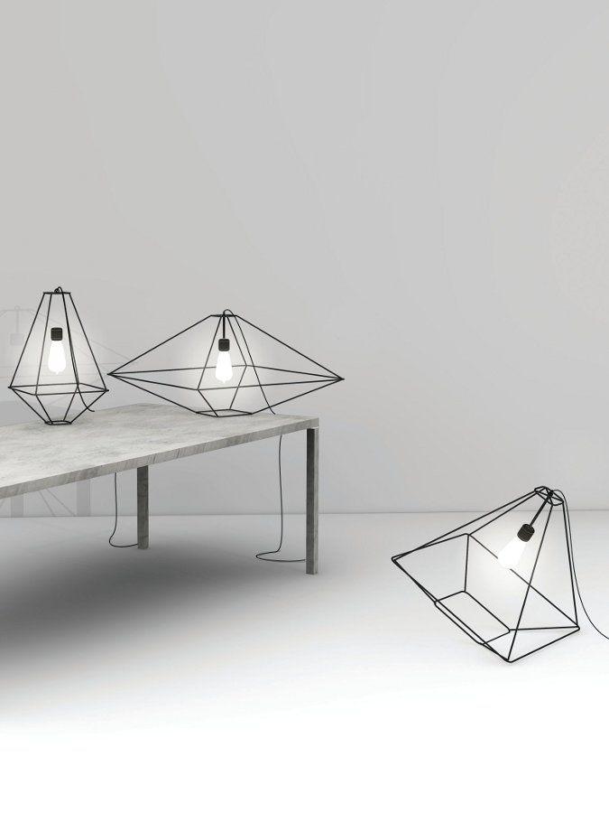 Opinion Ciatti at Fuorisalone lighting lights grey bulbs metal casing geometric shapes grey walls