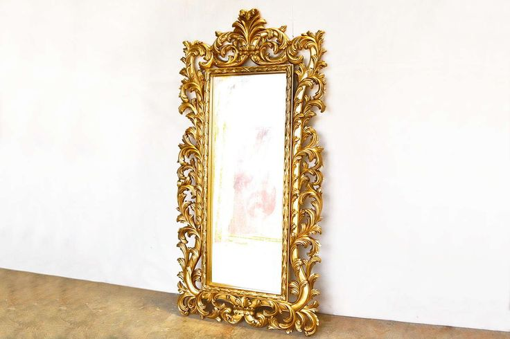 A beautiful mirror frame handcrafted of mahogany wood decorated witn acanthus wood carving