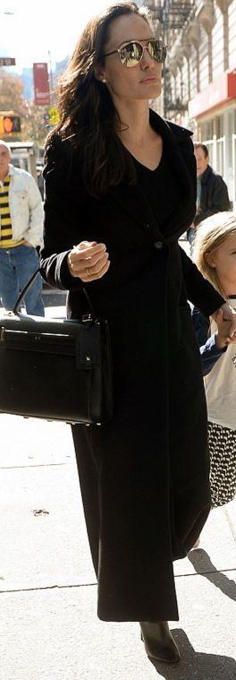 Who made  Angelina Jolie's black tote handbag and gold aviator sunglasses?