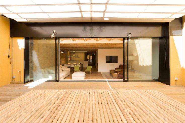 4 slide pieces top hidden frame aluminium window by Technal.   Portaferrissa apartment by Ambit Arquitectes in Gothic Quarter, Barcelona