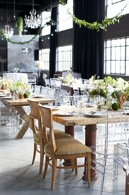 "A Magnificent Calgary Wedding Fuses Classic & Fun #refinery29  http://www.refinery29.com/martha-stewart-weddings/11#slide11  Garlands were hung over long tables set in a neutral palette while clear chairs added a modern vibe. ""We wanted our wedding to feel like a dinner party we were hosting at our home,"" Emily said. ""Keeping with that theme, some of the greenery (like hops) featured on the tables was cut from our backyard."""