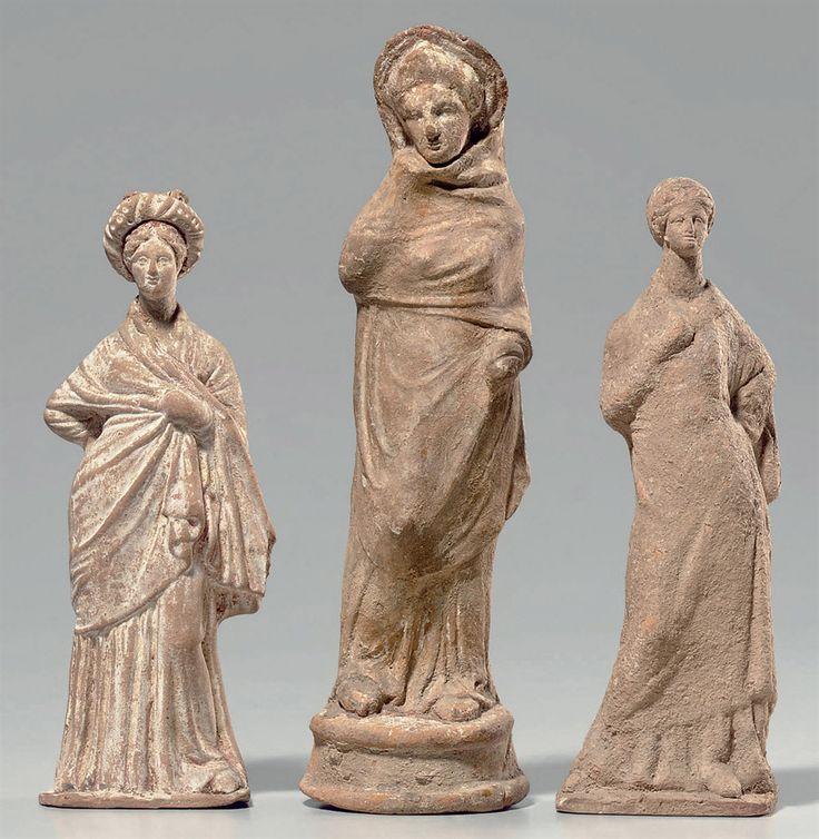 THREE GREEK POTTERY FEMALE FIGURES