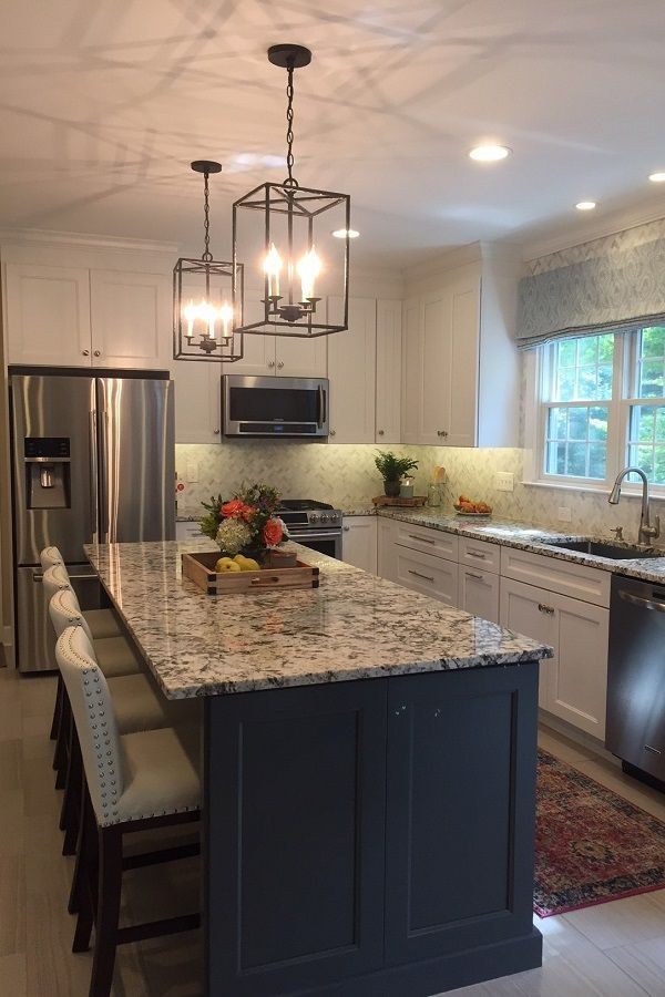 A big island in a contrasting color adds function and fashion to any kitchen.  #ThomasvilleCabinetry #KitchenInspo #KitchenRemodel