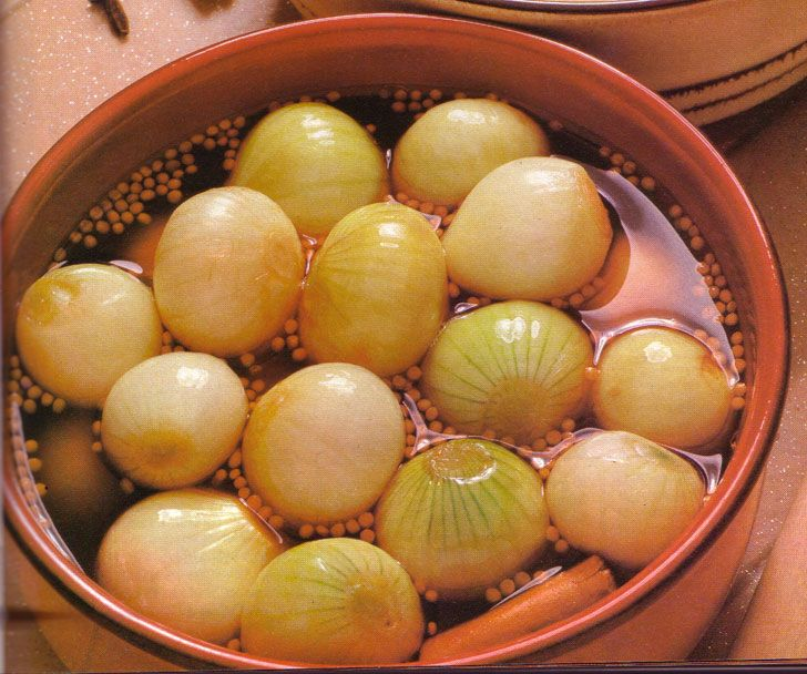 Portuguese Pickled Onions.  My dad usued to make them with hot peppers inside