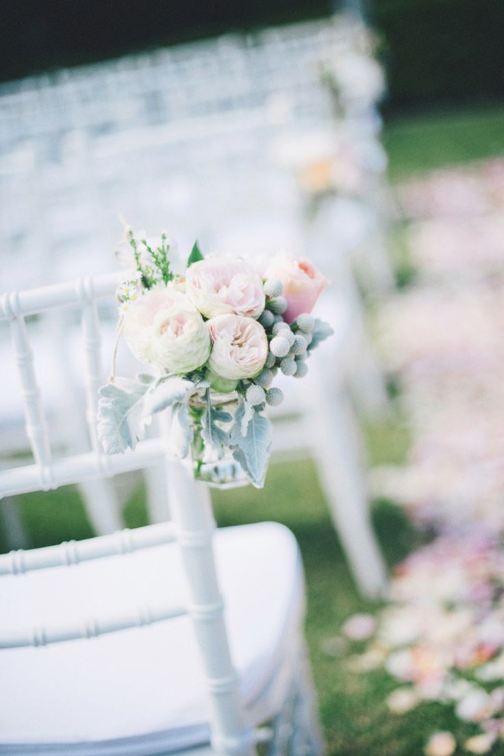 Flowers in jars to line the ceremony aisle | A Dreamy Pastel Wedding in Perth: Sam and Emma