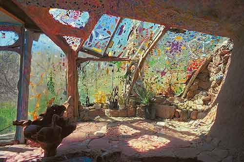 Mike Kahn built this room out of salvaged auto windshields, glued together with silicone caulk and decorated with stained glass.