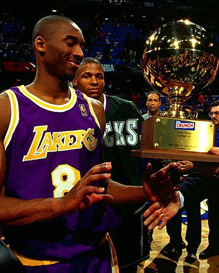 Kobe Bryant accepting his slam dunk championship trophy.