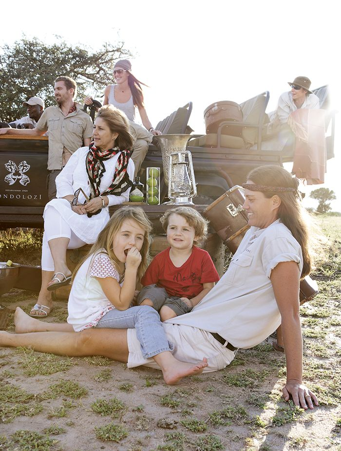 Kate with children, Emma and Thomas, and her extended Londolozi family. Photograph by Elsa Young