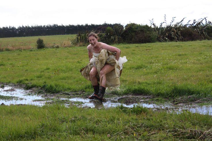 Puddle jumping. Trash my wedding dress