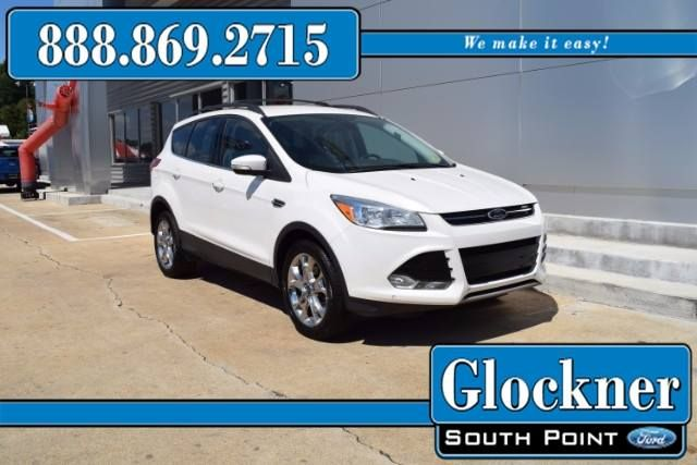 Check out this Ford Escape.   Only $16499!   That is an estimated $266 monthly payment.  This Escape has electronic stability leather upholstery automatic temperature control wireless phone connectivity front dual zone A/C auto-dimming rearview mirror split folding rear seat and memory seating.   At this price it wont last long.  Stop in to Glockner South Point Ford and check us out!    We Make Ownership Easy!