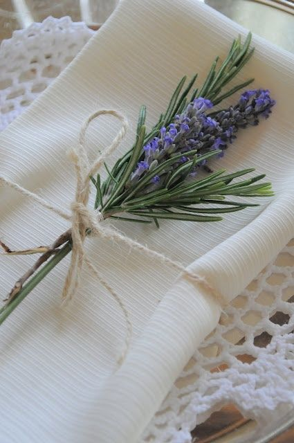 napkin tied with rosemary, lavender and a brown tag saying 'happy mothers day'