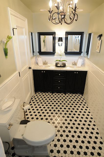 black and white bathroom I like this because you can accent with any color.  Get tired of that color, switch it out!