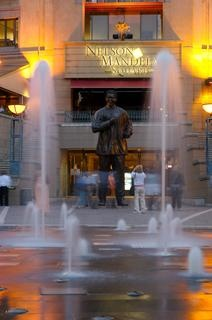 Nelson Mandela Square - A shopping and restaurant hub in Sandton, Johannesburg. In the outdoor square, or piazza, you will find a six-metre tall statue of Nelson Mandela sculpted by Kobus Hattingh and Jacob Maponyane – an imposing reminder of South Africa's favourite grandfather who continues to inspire.