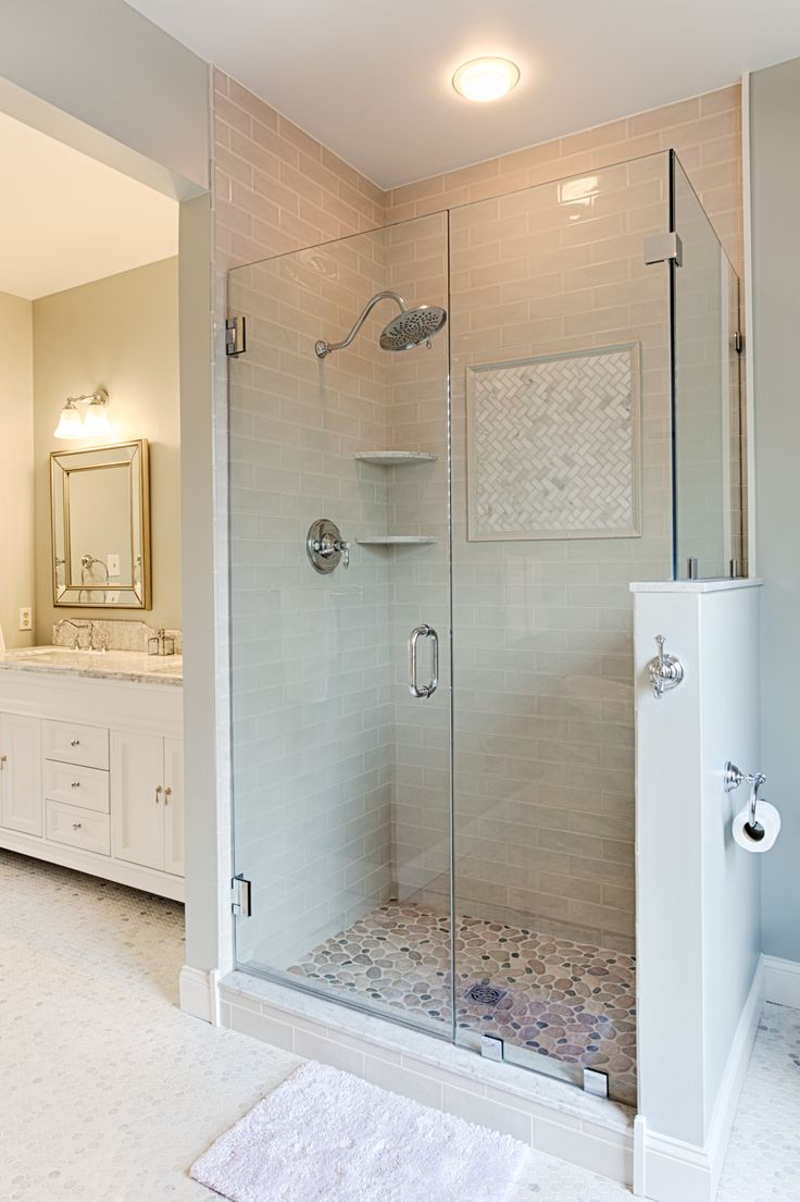Frame-less glass enclosure add elegance to this over sized shower stall.