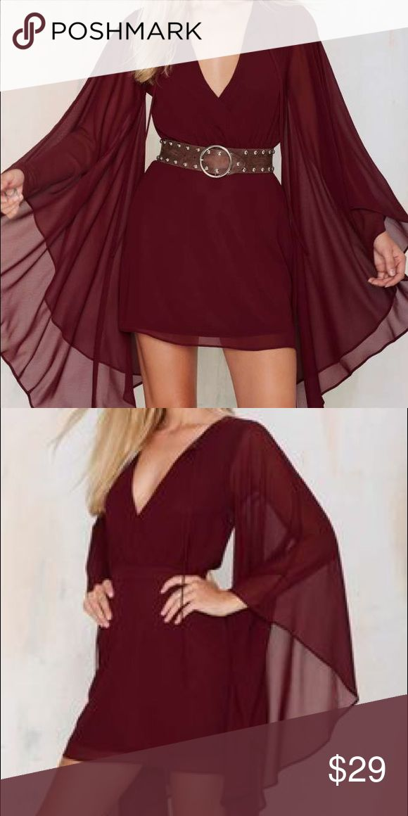 """✨NWT Nasty Gal Burgundy """"Bells & Whistles"""" Dress✨ Super cute and chic Nasty Gal burgundy chiffon """"Bells & Whistles"""" dress! V-neckline, side zip closure, dramatic bell sleeves that have beautiful length and fan out. Length hits above the knee, light chiffon material. Never worn because it was too small for me. Brand new with tags. Pair with a cute leather belt at waist and chunky heels of boots!❤️ Nasty Gal Dresses Long Sleeve"""