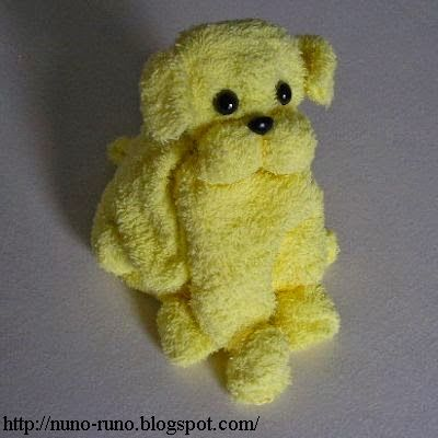 Towel dog  www.TopsyTurvyDiaperCakes.com * diaper cakes for baby shower & washcloth favors