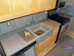 Concrete Countertop and Sink in Chicago Illinois. love the concrete farmer sink.