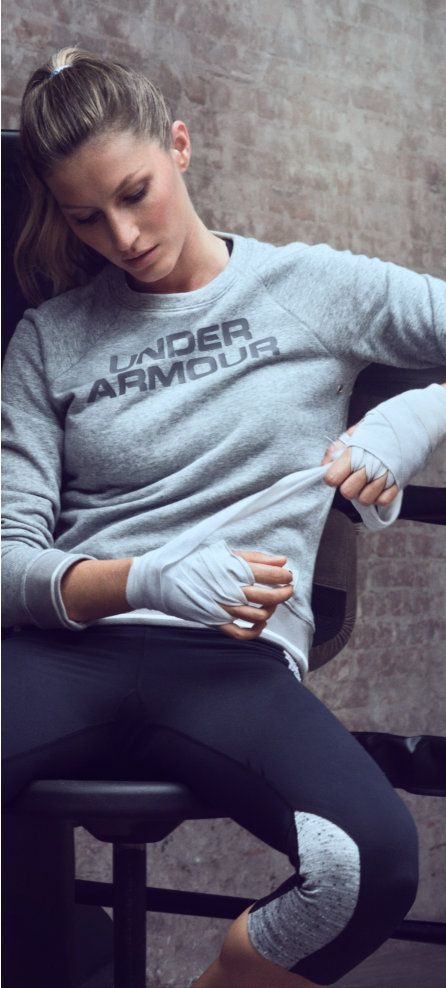 Shop Gisele Bündchen's Workout Clothes - Shop Gisele's workout gear, featuring the UA Legacy East French Terry Crew, Eclipse bra, Long & Lean scoop neck shirt, and StudioLux Step It Up capris.