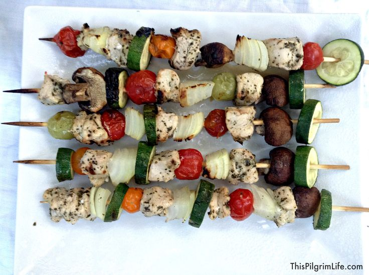 Copycat Zoe's Kitchen- An easy, at-home version of Zoe's grilled chicken kabobs, rice, and Greek salad.