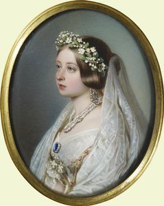 Queen Victoria in her wedding dress. As a surprise present to Albert for their seventh wedding anniversary in 1847, Queen Victoria asked Winterhalter to paint her portrait in her wedding clothes. This is a miniature copy after Winterhalter's portrait which is also in the Royal Collection. It shows her wearing a wreath of orange blossom, the diamond and sapphire brooch given to her by Albert on her wedding day, and the collar of the Order of the Garter.
